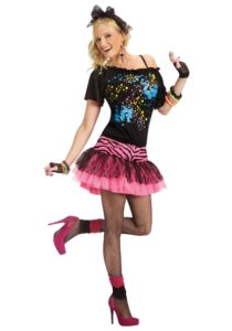 Woman wearing 80s costume with pink heels and glitter galore