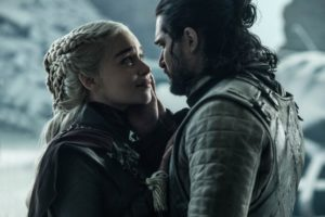 Jon Snow and Daenerys, wrapped in winter clothing, lean closely into each other in the final moments of Game Of Thrones.