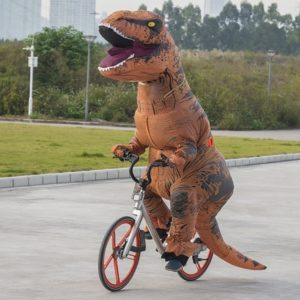 Inflatable dinosaur costume worn while riding a bike