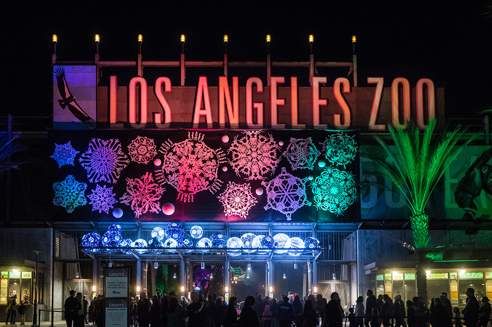 """Los Angeles Zoo"" sign shines bright with a colorful assortment of holiday lights ."