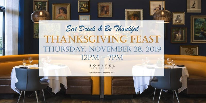 Softitel hotel yellow booths in Beverly Hills covered by a Thanksgiving Day graphic