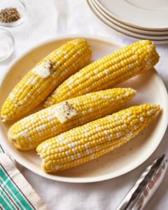 Multiple ears of corn, with butter melting on top