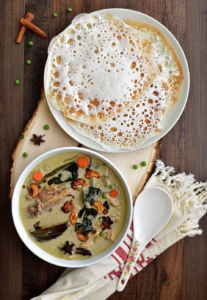 A Kerala Appam pancake is paired with traditional Indian Chicken Stew for a hearty meal made typically for Easter and Christmas.