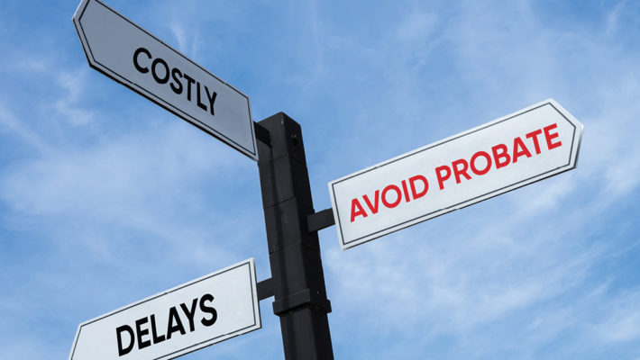 three way road sign labeled avoid probate in red text and delays and costly in black text