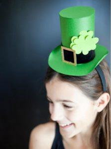 A green leprechaun hat atop a headband, with shamrock on full display