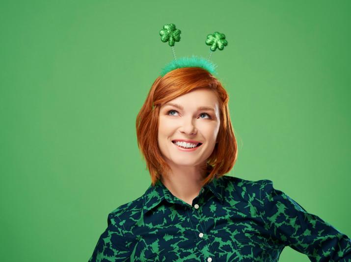 Ginger woman wearing a Shamrock headband
