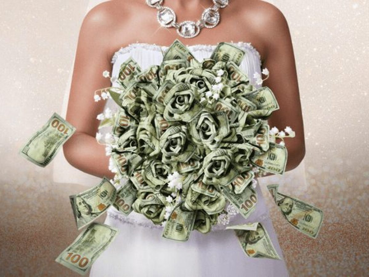 white and beige background sparkles pictured woman's body not showing head with a large diamond necklace wearing a wedding dress holding a bouquet of $100 bills that look like roses