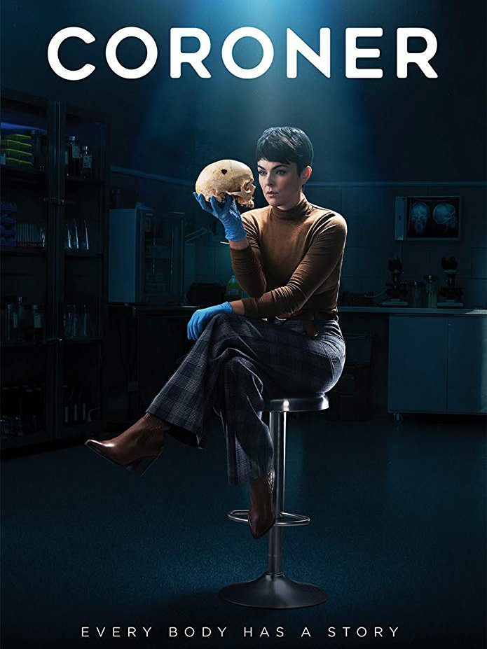 coroner female actor sitting on a metal barstool in the middle of a medical room that is dark and surrounded with medical supplies she is wearing blue plaid pants with brown boots and a brown turtle neck her legs are crossed she has blue medical gloves on and holding a human skull in one hand while staring at it with the caption every body has a story