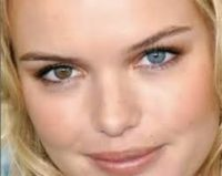 kate bosworth's close up face with a small smile and two different colored eyes brown and blue