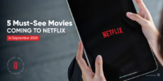 5 Must-See Movies Coming to Netflix in white text overlayed on a photo of an iPad of someone watching Netflix