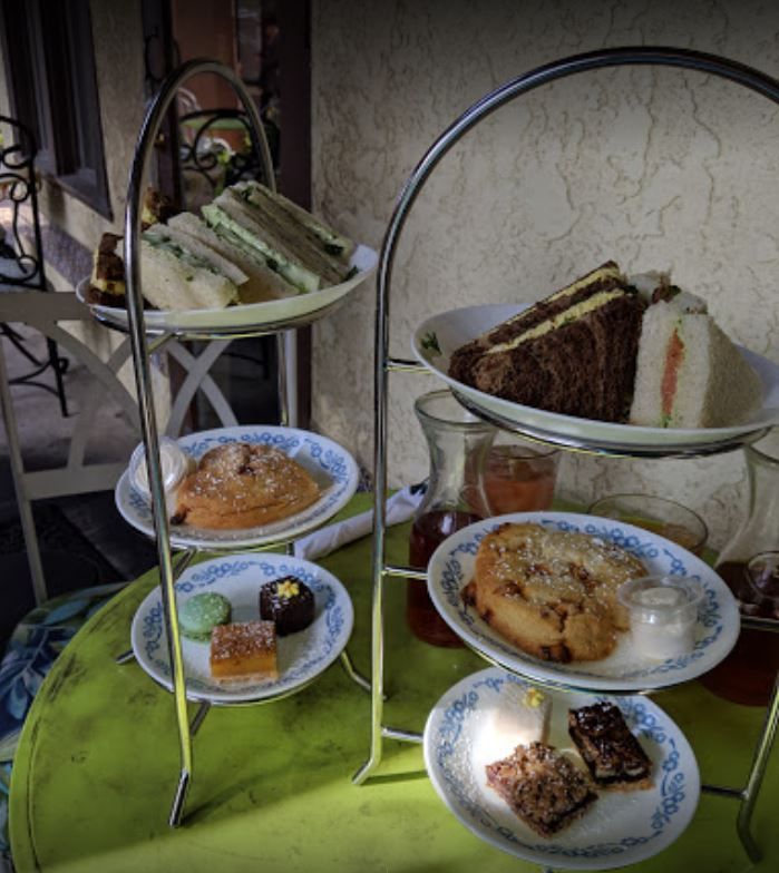 green lazy susan with plates of small desserts
