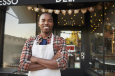 A Los Angeles Black owned business, with the owner standing in front