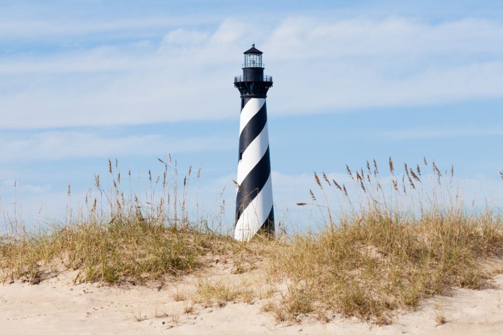 Black and White striped lighthouse on the beach in Cape Hatteras, North Carolina