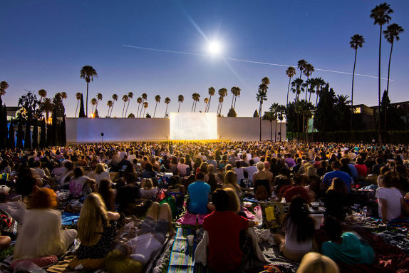 Large crowd of people watching a film at the Hollywood Forever Cemetery