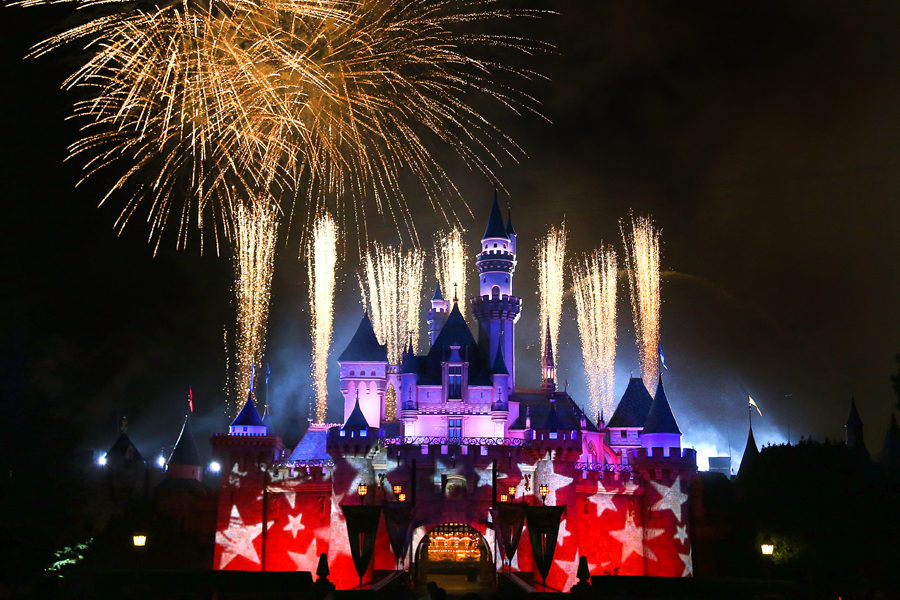 Disneyland Castle with projection of patriotic stars and fireworks above