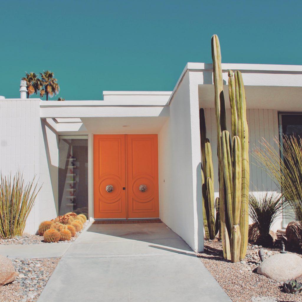 Orange door on modern home in Palm Springs, California