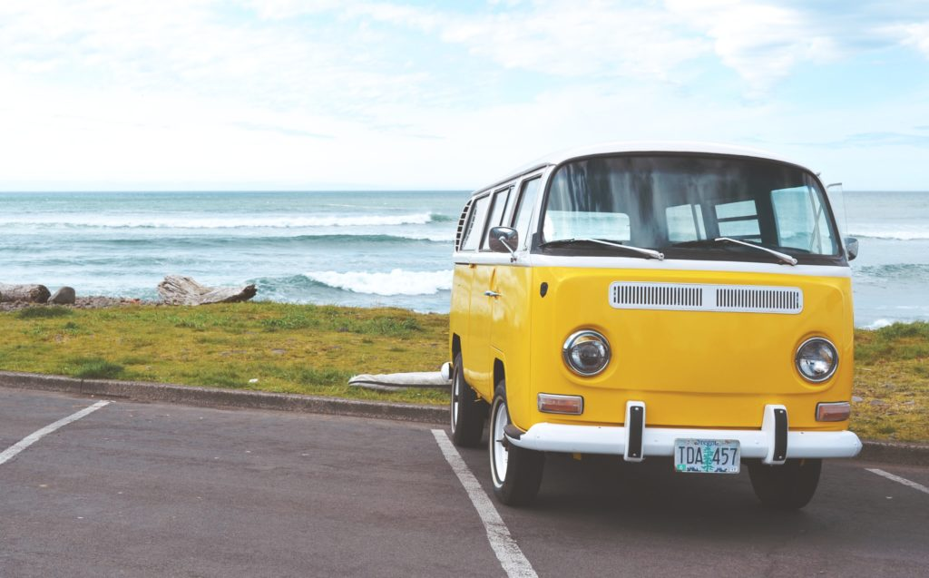 Yellow Volkswagon bus parked on the coast in Seaside, Oregon