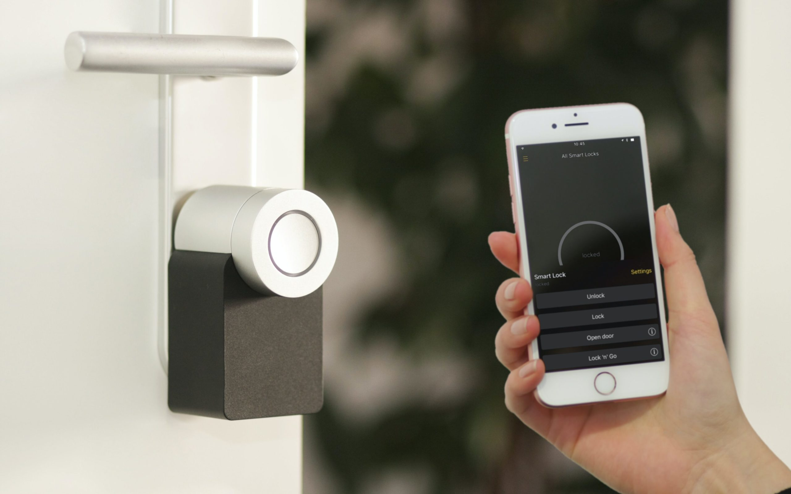 an iphone unlocking a home's front door using the smart lock app