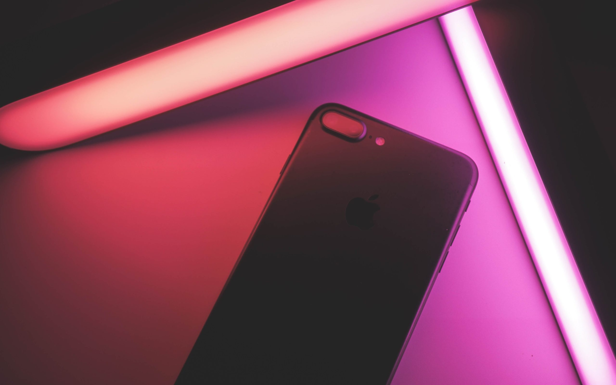 iphone being illuminated by colorful LED smart lights