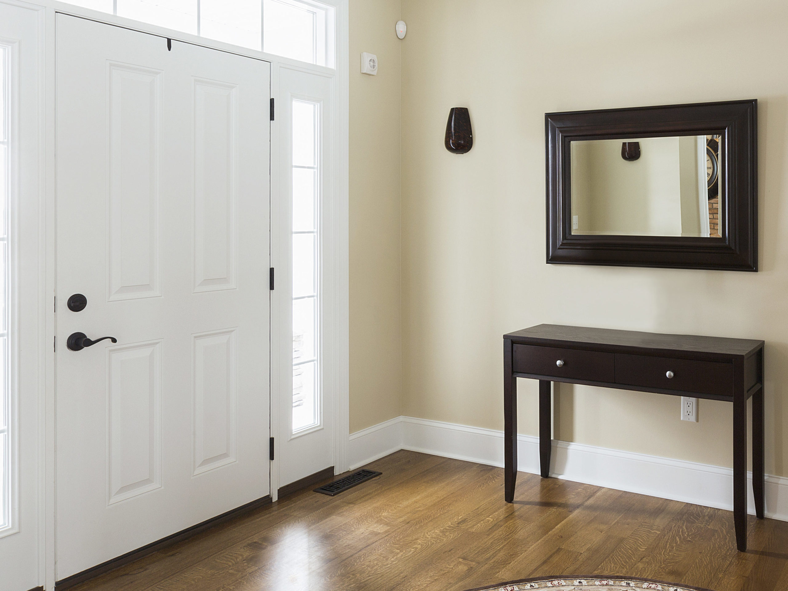 Table and mirror in modern entryway