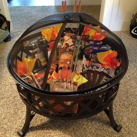 a housewarming gift of a firepit filled with s'mores ingredients